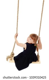 Adorable little girl swinging on a swing. She is happy to have fun and show how she can do it. The concept of summer recreation and harmonious development of the child. Isolated on white background.