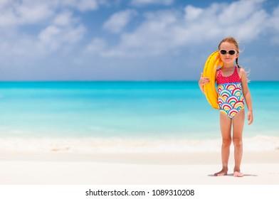 Adorable little girl at tropical beach