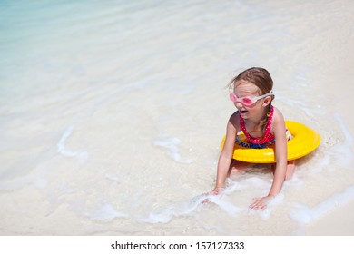 Adorable little girl at tropical beach