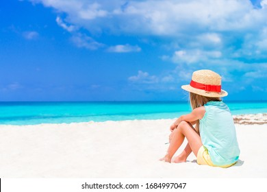 Adorable little girl at tropical beach on vacation