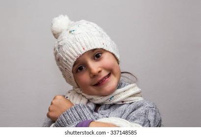 adorable little girl wearing winter hat