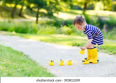 756a3d94a child playing in rain Images