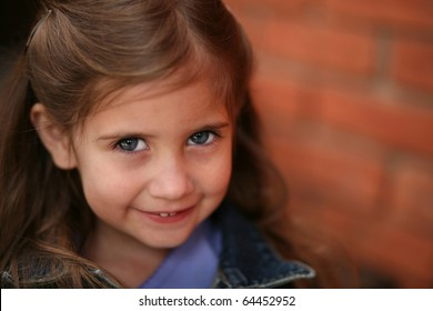 adorable little preschool age girl sitting and smiling