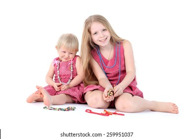 adorable little two sisters 9 year and  1  year old with apple on white background