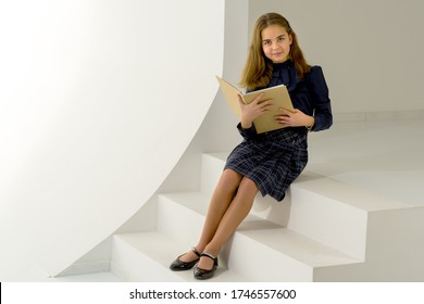 Adorable Long Haired Girl Sitting on Step and Smiling at Camera