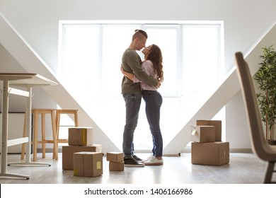 Adorable loving couple after moving into new house