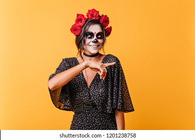 Adorable mexican female model enjoying halloween. Blissful girl in dead bride outfit expressing happiness.