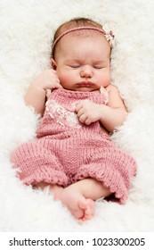 Adorable newborn baby girl sleeping