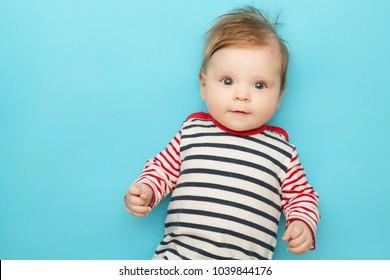 Adorable newborn portrait on the blue background, studio shot