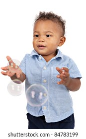 Adorable One Year Old African American Boy Playing Bubbles Isolated