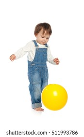 Adorable one year old child playing with yellow ball, isolated on white
