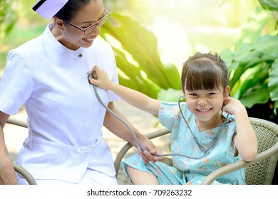 Adorable patient girl happy to playing with private nanny nurse during a rehabilitation session. Exclusive Creditor Protection and life Insurance Commercial Concept.