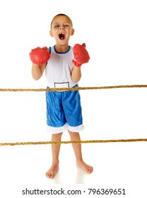 """An adorable preschooler loudly yelling """"Bring it on!"""" in his boxing shorts and gloves.  He has a black eye and a tooth is missing from his wide, opened mouth.  On a white background."""