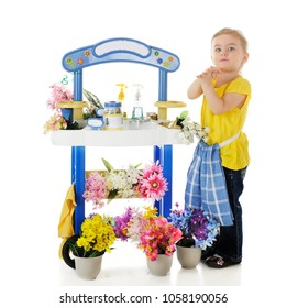 An adorable preschooler manning her own flower stand.  On a white background.
