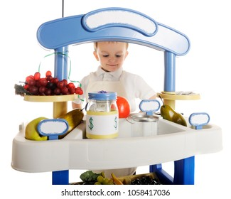An adorable preschooler manning his fruitstand.  The stand's signs are left blank for your text.  On a white background.