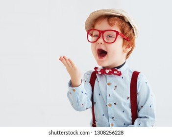adorable redhead toddler baby boy blowing a kiss