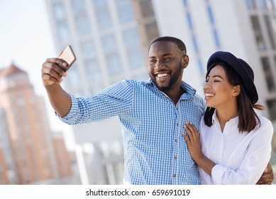 Adorable romantic couple taking a selfie together