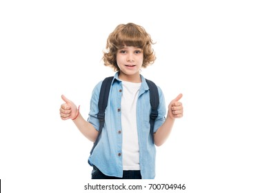 adorable schoolboy with backpack showing thumbs up, isolated on white