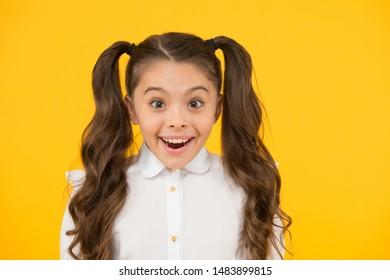 Adorable schoolgirl. Homeschooling or visiting regular school. Efficiency of studying. Emotional expression schoolgirl. Schoolgirl pupil long hair cute ponytails hairstyle. Educational program.