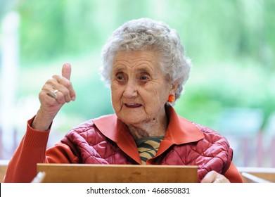 Adorable senior woman doing a good gesture