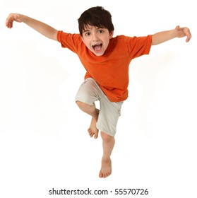 Adorable seven year old boy pretending to do kung fu or being a bird.