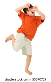 Adorable seven year old boy with tongue out and thumbs down over white background.