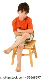 Adorable seven year old Caucasian boy with unhappy or bored expression.
