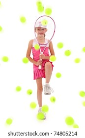 Adorable seven year old caucasian girl in tennis uniform defending herself with racquet being pelted by tennis balls over white.