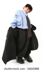Adorable seven year old french american boy in over sized large suit over white.