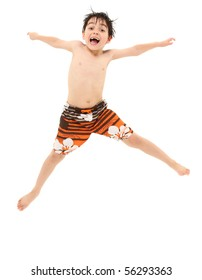 Adorable seven year old french american boy in swim suit and wet hair jumping excited about going swimming.