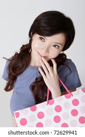 Adorable shopping woman thinking with attractive expression on face.