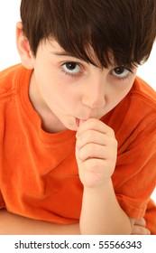 Adorable six year old boy sucking his thumb.