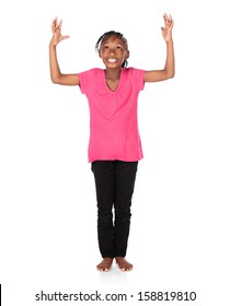 Adorable small african child with braids wearing a bright green shirt and black skinny jeans. The girl is worshipping with her hands lifted up.