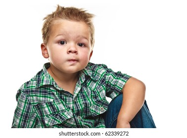 Adorable small boy looking at the viewer in a pensive mood.