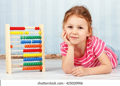 Adorable smart child with abacus