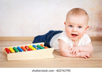 Adorable smiling  baby boy crawling on the floor