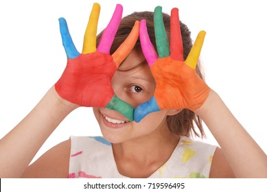 Adorable smiling little girl, looking through colored hands and dress isolated on a white background