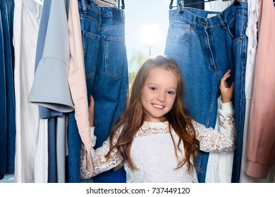 adorable smiling stylish child posing in boutique