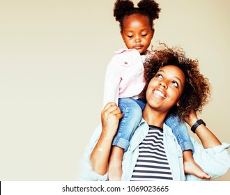 adorable sweet young afro-american mother with cute little daugh