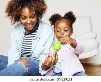 adorable sweet young afro-american mother with cute little daughter, hanging at home, having fun playing smiling, lifestyle people concept, happy smiling modern family