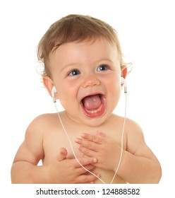 Adorable ten month old baby listening to music on ear buds.