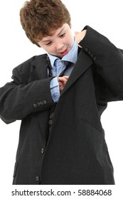 Adorable ten year old american boy in baggy blue suit looking in jacket pocket over white background.