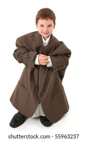 Adorable three year old boy in over sized suit over white.