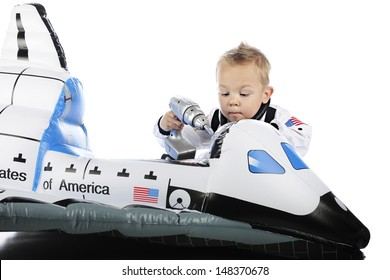 """An adorable toddler """"astronaut"""" using a toy screwdriver to """"repair"""" his toy space shuttle.  On a white background."""