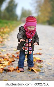 Adorable toddler in beautiful autumn park