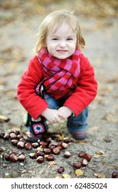 Adorable toddler girl outdoors on beautiful autumn day
