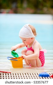 Adorable toddler girl playing in swimming pool