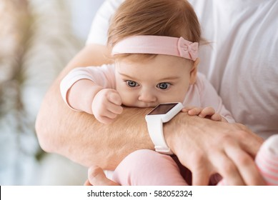 Adorable toddler girl resting with her father