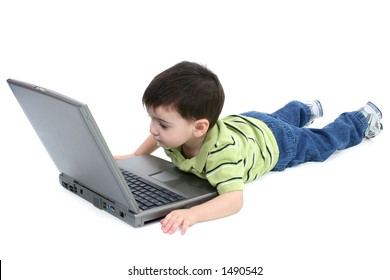 Adorable toddler looking at laptop screen. Full body. Clipping Path.