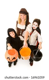 Adorable trick or treaters in halloween costumes, begging for candy.  Full body isolated on white.